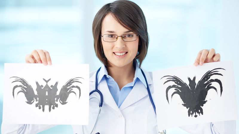 Smiling psychiatrist showing two different pictures